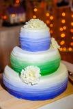 Beautiful three-layer wedding cake on the table Royalty Free Stock Photo