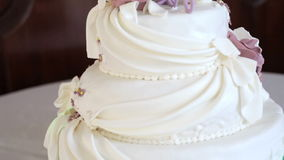 Beautiful three-tiered wedding cake Stock Photos