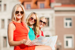 Beautiful three women with tourist map in the city Royalty Free Stock Images