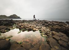 A lone silhouette on the Giant`s Causeway of Northern Ireland stock images