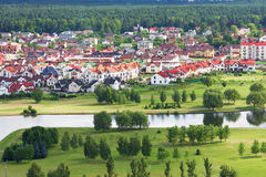 Beautiful and tidy living quarters in Minsk, Belarus cituated ne. Ar green park and river. White houses with red roofs Stock Photography