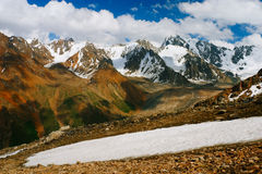 Beautiful Tien shan peaks and mountains near Almaty. Dramatic overcast sky. Beauty world stock photo