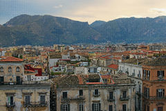Beautiful tiled roofs of old houses. Nice mountain in the background. Palermo. Sicily. Royalty Free Stock Image