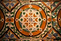 Beautiful tiles panel with traditional patterns, made in 15th -16th century, Spain. Beautiful tiles panel with the traditional patterns, made in 15th -16th stock photography