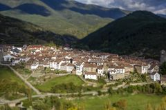 Beautiful tilt shift effect panoramic view of spanish town in a green valley. Spain royalty free stock image