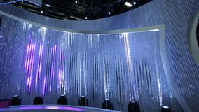 Beautiful Tilt up from empty stage to shiny beaded curtain to top of studio/set stock footage