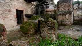 Beautiful tilt up of ruins surrounded by greenery stock video footage