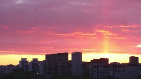 Beautiful time lapse view of sunset sky in city with buildings. Time lapse of clouds moving on evening sky over cityscape stock video