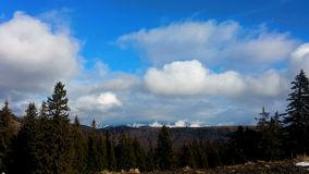 Beautiful timelapse clouds over mountain ridge in autumn. Hd video stock video footage