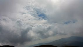 Beautiful timelapse clouds over mountain ridge. Hd video stock footage