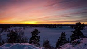 Beautiful timelapse of sunset at winter in Katrineholm Sweden Scandinavia. Lovely colorful sky at cold dusk evening. Nice nature and landscape video. Calm stock footage