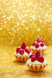 Beautiful tiny cupcakes with wild strawberries. Party dessert Stock Photo