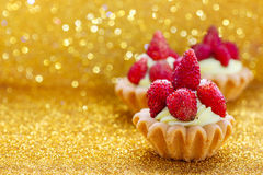Beautiful tiny cupcakes with wild strawberries Stock Photo