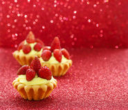 Beautiful tiny cupcakes with wild strawberries Royalty Free Stock Image