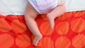 Beautiful tiny legs on newborn baby. stock video