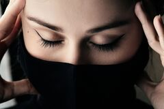 Free Beautiful Tired Girl In A Black Mask Holding Hands Behind Her Head In Despair, Epidemic Problem 2020, Danger Concep Stock Photography - 180407312