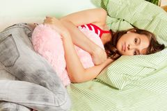 Beautiful but tired teenage girl in her bed Royalty Free Stock Photo