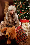 Beautiful tired woman with Christmas presents Stock Photography