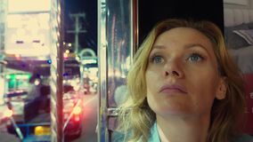 Beautiful tired young woman blonde portrait inside a tuk tuk on a night street. tourism concept stock video