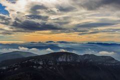 It is beautiful to see the mountains at dawn with the low clouds and the fog from the Puig Bassegoda stock photography