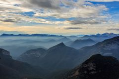 It is beautiful to see the mountains at dawn with the low clouds and the fog from the Puig Bassegoda royalty free stock images