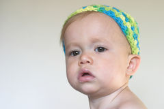 Beautiful Toddler. Image of beautiful toddler with a serious look on his face Stock Image