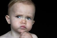 Beautiful Toddler. Image of beautiful toddler with a thoughtful look on his face Stock Images