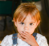 Beautiful toddler with big eyes looks at the camera Royalty Free Stock Photo