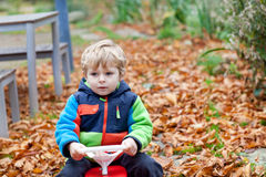 Beautiful toddler boy in autumn park Royalty Free Stock Images