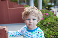 Beautiful toddler boy on balcony Stock Photo