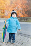 Beautiful toddler boy in blue clothes dreaming. On sunny winter day royalty free stock photos