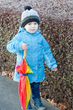 Beautiful toddler boy in blue clothes dreaming. On sunny winter day stock image