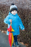 Beautiful toddler boy in blue clothes dreaming. On sunny winter day royalty free stock photography