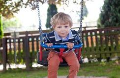 Beautiful toddler boy having fun on swing Royalty Free Stock Photos