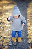 Beautiful toddler boy walking outdoors Royalty Free Stock Image