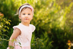 Beautiful Toddler a Garden Looking at Camera Stock Image