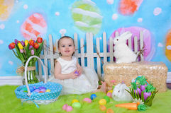 Beautiful toddler girl in easter scene Stock Photos