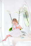 Beautiful toddler girl playing with cosmetics Royalty Free Stock Image