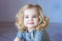 Beautiful toddler girl smiling. Ð¡lose-up portrait. Blue eyes. stock photography