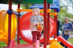 Beautiful toddler on playground Stock Image