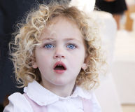 Beautiful toddler portrait. Portrait of a pretty toddler with blue eyes and blond curly hair Royalty Free Stock Images