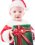 Beautiful toddler Santa with Christmas gift Royalty Free Stock Images