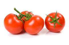 Beautiful tomatoes isolated on the white stock photography