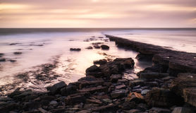 Beautiful toned seascape landscape of rocky shore Stock Photos