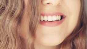 Beautiful toothy smile of young woman with perfect healthy white teeth, health and beauty