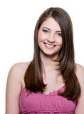 Beautiful toothy smiling woman. Portrait of happy cheerful beautiful woman with brown straight hair Stock Images