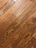 Beautiful top shoot of the brown maple hardwood floor. Close up of hardwood flooring royalty free stock image