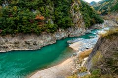 Top view of  Katsura River at Kyoto japan in autumn. The Beautiful top view landscape of the Katsura River area in autumn in Arashiyama, one of landmark in Kyoto Royalty Free Stock Photography
