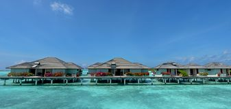 Beautiful tropical landscape panorama view of water bungalows. At Maldives Royalty Free Stock Photo