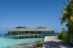 Beautiful topical landscape view with over water building. At Maldives Stock Image